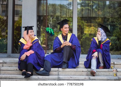 KUALA LUMPUR, MALAYSIA-20 DEC 2017: Three happy graduate with graduation gown and hat.