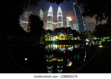 KUALA LUMPUR, MALAYSIA-2019, Jan 19: Reflection view of Petronas Twin Towers on the Kuala Lumpur City Centre (KLCC) Lake at KLCC Park. Petronas Twin Towers is the most visited place for tourist in KL.