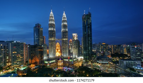 Kuala Lumpur, Malaysia-August 1 2017: KLCC at blue hour with new Robertson hotel.