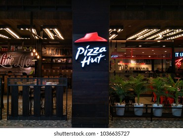 Kuala Lumpur, Malaysia-February 28, 2018: Pizza Hut restaurant in the shopping mall. Pizza Hut is an American restaurant chain and international franchise founded in 1958 by Dan and Frank Carney.