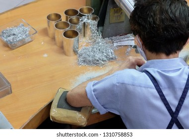Kuala Lumpur, Malaysia-JAN 23,2019: Tourists visit the production process of kitchenware, jewelry accessories from tin ore mixed with antimony and copper called Pewter. This factory is named Rayal Sal
