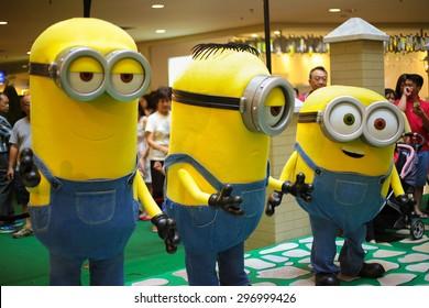 "KUALA LUMPUR, MALAYSIA-June 14, 2015 : Bob, Stuart and Kevin, mascots of the movie ""Minions"" at Mid Valley mall promotional roadshow, Malaysia 2015."