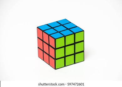 KUALA LUMPUR - MAR 04th, 2017: Colourful Rubik's cubes on white background. Rubik's Cube invented by a Hungarian architect Erno Rubik in 1974 is famous 3 dimensional puzzle. Solving difficult IQ quiz.