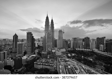 KUALA LUMPUR - MARCH 02, 2016 - Majestic view of Petronas Twin Towers during sunset with dramatic sky in black and white. Petronas Twin Towers also known as KLCC is the tallest building in Malaysia.
