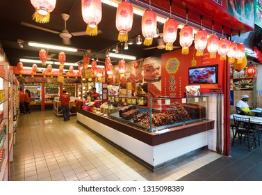 KUALA LUMPUR - MARCH 13, 2017: The interior of a store with assorted dried meat in Jalan Alor Street famous with budget restaurants of various cuisines of the world.