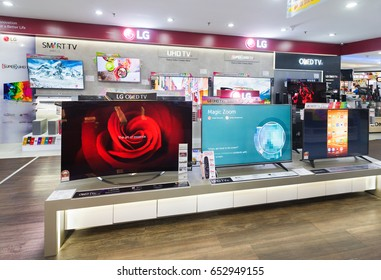 KUALA LUMPUR - MARCH 13, 2017: LG OLED TV screens in Low Yat Plaza. LG Corporation is a South Korean multinational conglomerate corporation being the fourth largest one in South Korea.