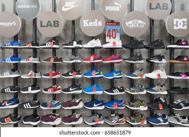 KUALA LUMPUR - MARCH 13, 2017: Footwear of various brands in the Royal Sporting House store in Plaza Low Yat. The mall is located in Bukit Bintang, the shopping and entertainment district in the city.