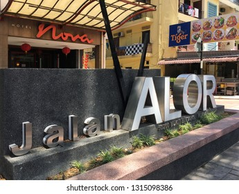 KUALA LUMPUR - MARCH 2018: The sign Jalan Alor (Alor Street in the Malay language). The street is known with its budget hotels and especially inexpensive restaurants of various cuisines.