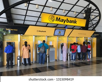 KUALA LUMPUR - MARCH 2018: Unidentified people stand at self service machines at the Maybank in Maybank Tower. The tower is the headquarters of Maybank and houses the Maybank Numismatic Museum