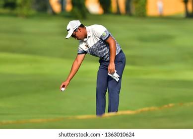 Kuala Lumpur - March 21: Natipong Srithong of Thailand,, drop the ball, during Round 1 of Maybank Championship 2019, at Saujana Golf & Country Club, Kuala Lumpur, Malaysia , on March 21, 2019.