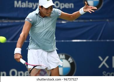 KUALA LUMPUR -MARCH 3: Eleni Daniilidou returns a ball during a single quarter-finals match against Olivia Rogowska at the BMW Malaysian Open on March 3, 2012 in Kuala Lumpur, Malaysia. Daniilidou wins (6-2,3-6,6-2)