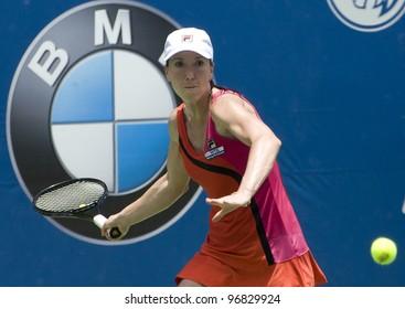 KUALA LUMPUR - MARCH 4: Jelena Jankovic (SRB) returns ball to Petra Martic(CRO) at semi final match, Martic win with 7-6, 5-7, 6-7 during BMW Malaysian Open in Kuala Lumpur, Malaysia on March 4, 2012