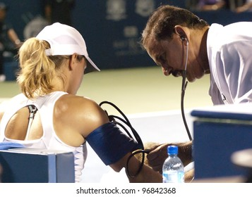 KUALA LUMPUR - MARCH 4: Petra Martic checked by doctor of the match during final match BMW Malaysian Open in Kuala Lumpur, Malaysia on March 4, 2012