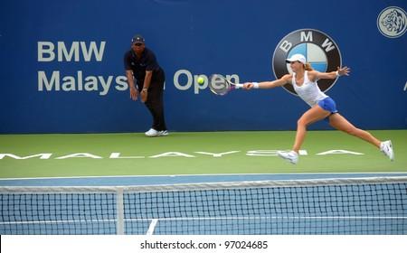 KUALA LUMPUR -MARCH 4: Petra Martic returns ball during quarter final match against Shuai Pheng(CHN) at the BMW Malaysian Open on March 4,2012 in Kuala Lumpur.Petra Martic win  4-6, 7-6(3), 6-4