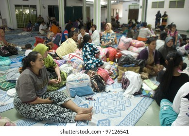 KUALA LUMPUR - MARCH 8: Situation of flash flood victims in temporary settlements in Surau Ehsaniah, Ampang, near Kuala Lumpur, Malaysia on March 8, 2012