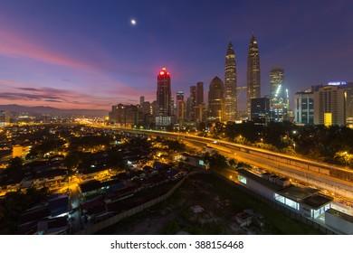 KUALA LUMPUR May 15 2015 : Petronas Twin Towers at sunrise with beautiful vibrant sky on 15 May 2016 in Kuala Lumpur. Petronas Twin Towers also known as KLCC is the tallest building in Malaysia.