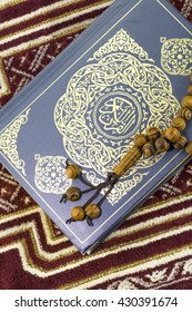 KUALA LUMPUR, May 2016: A close-up of The Holy Quran,Sajadah and Tasbih. Sajadah being use as prayering mat.