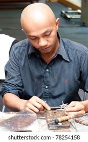 KUALA LUMPUR - MAY 28 : Mohd Khairi Abdullah, a traditional Silver Filligree crafter does a demonstration at the Malaysia Wedding Craft Day 2011 on May 28, 2011 in Kuala Lumpur, Malaysia.