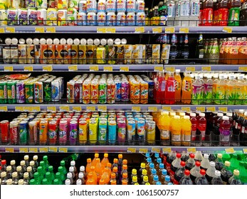 Kuala Lumpur, MY - APRIL 1, 2018: Various of soft drinks, waters, soda and juice fruits are sale on the refrigerator cooler shelf in a hypermarket.