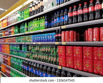 Kuala Lumpur, MY - APRIL 1, 2018: Various of colorful soft drinks are sale on the refrigerator cooler shelf in a hypermarket.