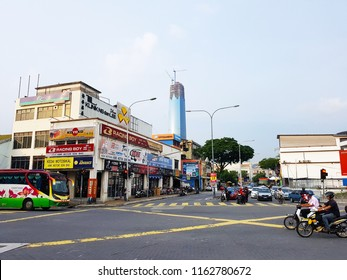 Kuala Lumpur, MY - APRIL 1, 2018: The main intersection avenue in Pudu City that have some cars and motorbikes running to their working places in morning.