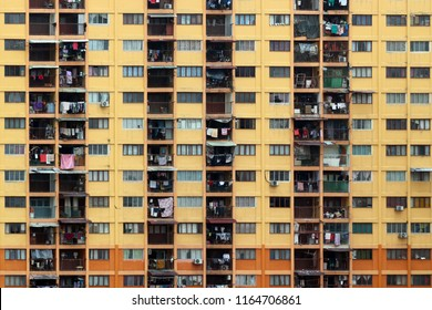 Kuala Lumpur, MY - APRIL 1, 2018: The old yellow-orange grunge residential apartments standing in the slum zone near the downtown street of Pudu City.
