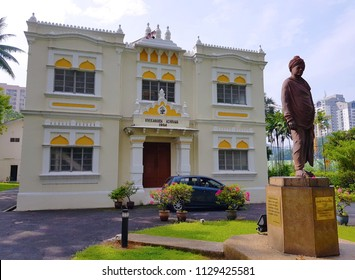 Kuala Lumpur, MY - MARCH 31, 2018: 112-years-old Vivekananda Ashram building, with the bronze statue of Swami Vivekananda, one of the official heritage iconic status in Brickfields street.