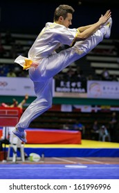 KUALA LUMPUR - NOV 03: Michal Frosik of Poland shows his fighting style in the 'changquan compulsory' event at the 12th World Wushu Championship on November 03, 2013 in Kuala Lumpur, Malaysia.