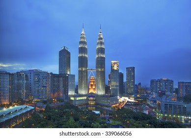 KUALA LUMPUR - NOV 15 : The Petronas Twin Towers on November 15 , 2015, in Kuala Lumpur, Malaysia are the world's tallest twin tower. The skyscraper height is 451.9m