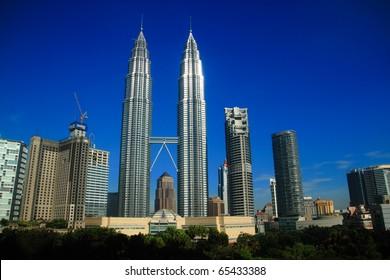 KUALA LUMPUR - NOV 16: The Petronas Twin Towers on November 16, 2010, in Kuala Lumpur, Malaysia are the world's tallest twin tower. The skyscraper height is 451.9m