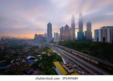 KUALA LUMPUR, November 16 2015 : Petronas Twin Towers at sunrise with vibrant sky on 16 November 2016 in Kuala Lumpur. Petronas Twin Towers also known as KLCC is the tallest building in Malaysia.