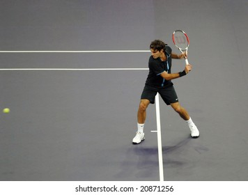 KUALA LUMPUR - NOVEMBER 18: Roger Federer of Switzerland swings for the ball during an exhibition tennis match in Showdown of Champions Event November 18, 2008 in Kuala Lumpur, Malaysia.