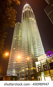 KUALA LUMPUR - OCT 25: The Petronas Twin Towers with Suria KLCC on October 25, 2014, in Kuala Lumpur, Malaysia are the world's tallest twin tower. The skyscraper height is 451.9m