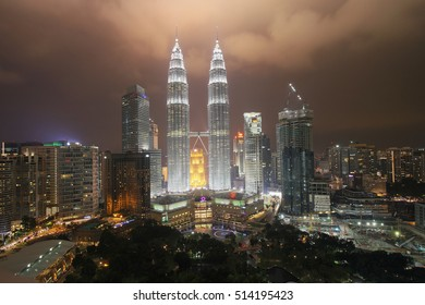 KUALA LUMPUR - OCT 27: The Petronas Twin Towers on October 27, 2016, in Kuala Lumpur, Malaysia are the world's tallest twin tower. The skyscraper height is 451.9m