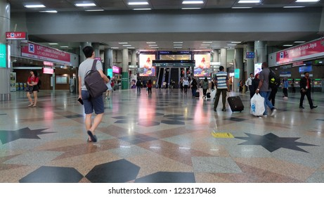 KUALA LUMPUR - October 10, 2018: Commuters in KL Sentral transportation hub in Brickfields, KL. KL Sentral is Malaysia largest intermodal transportation hub.