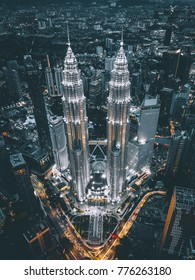 Kuala Lumpur, October 2017 - Cinematic aerial view of moody Kuala Lumpur City Centre from a drone