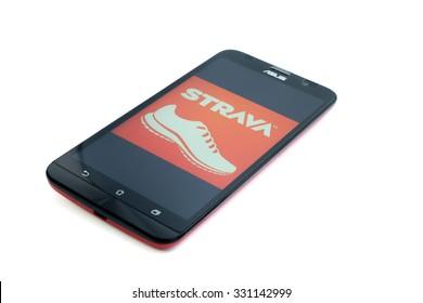 KUALA LUMPUR - OCTOBER 25,2015. Strava logo on smartphone.Strava is popular social fitness app.