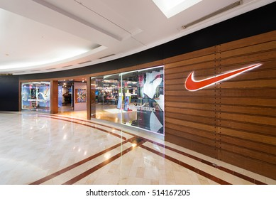 KUALA LUMPUR - SEP. 13, 2016: Nike store in the Suria KLCC mall. Nike, Inc. is an American corporation that manufactures and sells footwear, apparel, equipment, accessories and services worldwide.