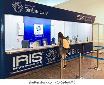 KUALA LUMPUR - SEPT 2017: A young woman gets GST refund at the Iris Global Blue counter in KLIA 2 airport. Approximately 52,000 people benefit each day from tax free shopping around the world.