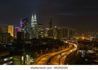 KUALA LUMPUR - SEPT 30 :Kuala Lumpur skyline with traffic car light on highway leading line to Twin towers during twilight at Kuala Lumpur Malaysia on 30th September 2016
