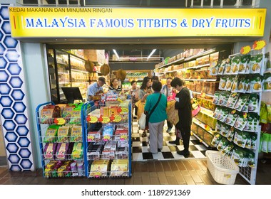 KUALA LUMPUR - SEPTEMBER 12, 2017: People buy goods at the Central Market. It was founded in 1888 and originally used as a wet market while the current Art Deco style building was completed in 1937