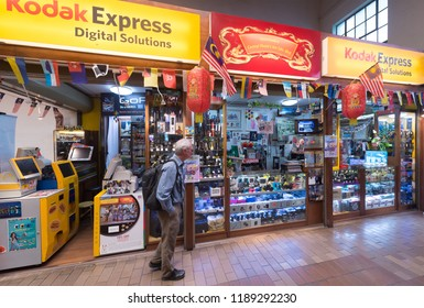 KUALA LUMPUR - SEPTEMBER 12, 2017: A man walks by Kodak Express boutique at the Central Market. Kodak Express is the world's largest branded photo processing network operating in 41 countries