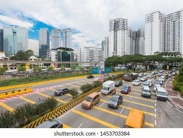 KUALA LUMPUR - SEPTEMBER 12, 2017: High angle view of traffic downtown the city. Kuala Lumpur is the national capital and most populous global city in Malaysia.