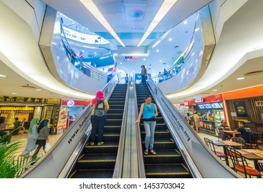 KUALA LUMPUR - SEPTEMBER 13, 2017: People move up and down on escalators at Plaza Low Yat. The shopping mall has a wide assortment of IT products.