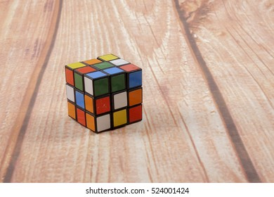 KUALA LUMPUR, SEPTEMBER 16, 2016: Rubik's Cube on the  Wooden Background, Free Space for Text