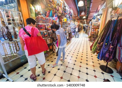 KUALA LUMPUR - SEPTEMBER 2017: Women choose handbags at the Central Market. It was founded in 1888 and originally used as a wet market while the current Art Deco style building was completed in 1937