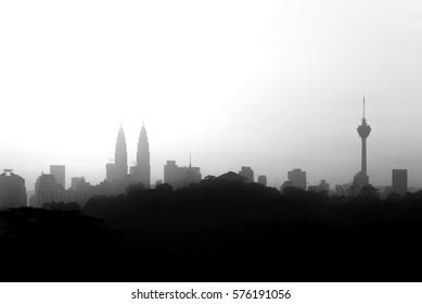 Kuala Lumpur skyline during morning in black and white.