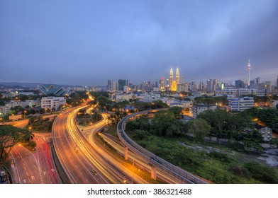 Kuala Lumpur skyline at dusk with hazy sky
