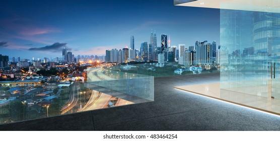 Kuala Lumpur skyline at night with balcony view
