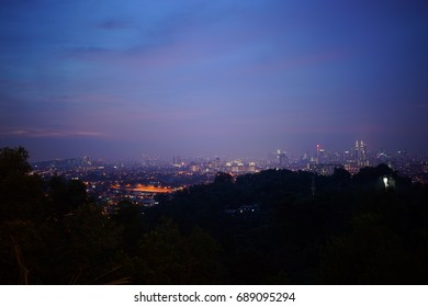 Kuala Lumpur Sunset View. Image contain noise and grain due to High ISO. Image also contain Soft Focus and Blur due to Long Exposure and wide aperture
